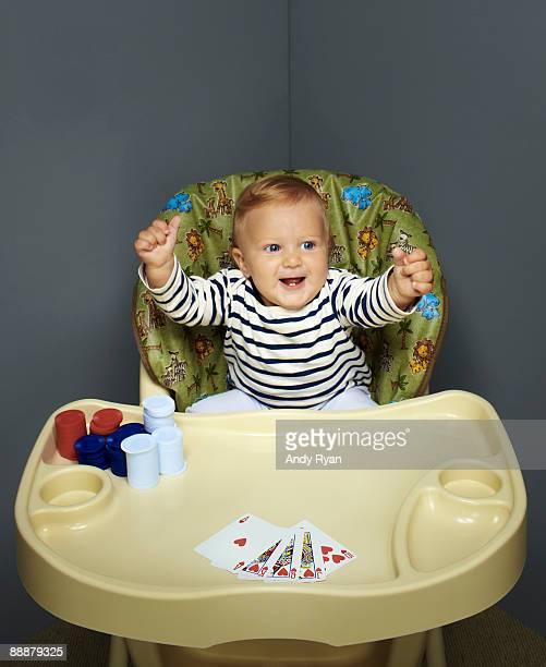 Child celebrating a winning poker hand