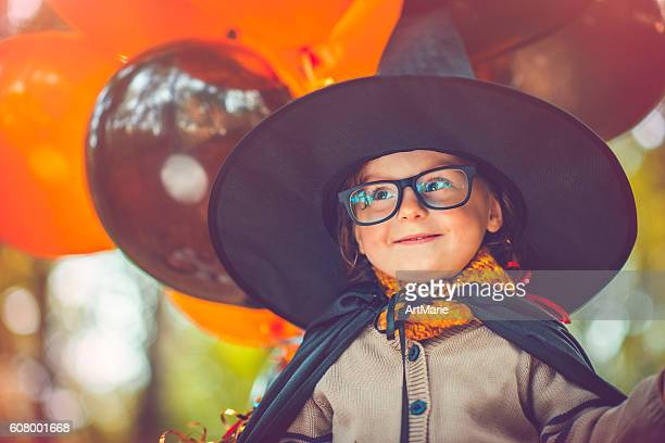child celebrating halloween - halloween kids stock photos and pictures