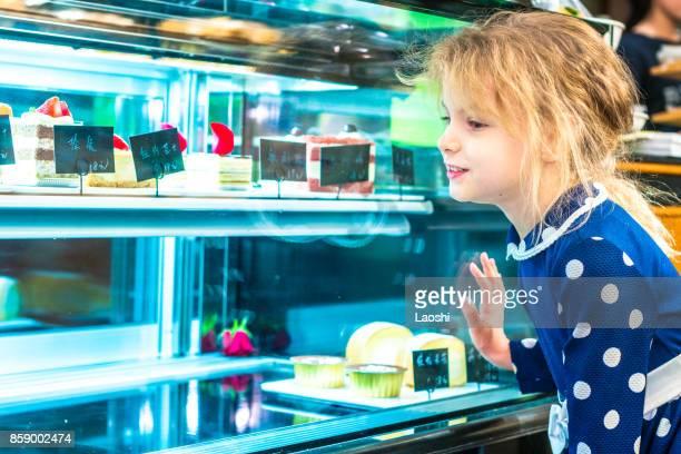 Child choosing a cake