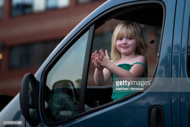 A child claps from a car window at the Royal Gwent Hospital on April 23 2020 in Newport United Kingdom Following the success of the Clap for Our...