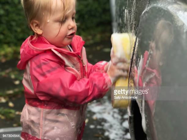 Child cleaning the car