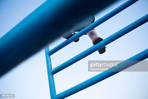 a child climbing on a jungle gym - ジャングルジム ストックフォトと画像