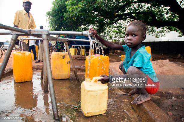 TOPSHOT A child collects water from a water point in Juba South Sudan on March 21 2017 International World Water Day is marked annually on March 22...