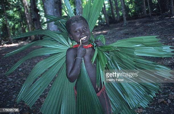 A child collects wild leaves to be used as plates for food