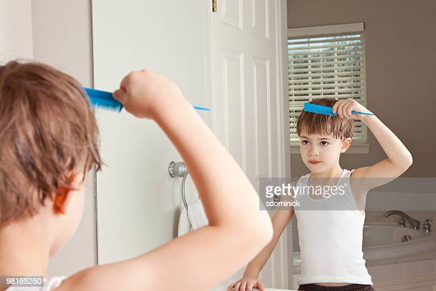 A Child Combing His Hair