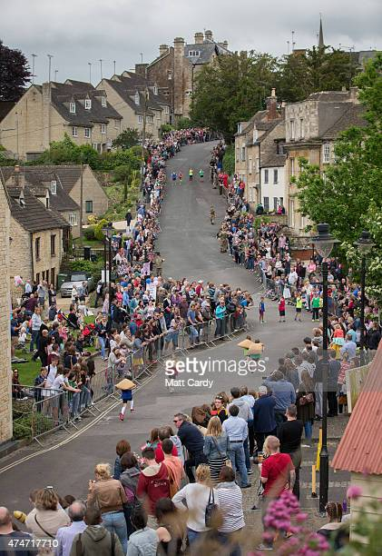 Child competitors race carrying woolsacks up the steep Gumstool Hill in the centre of Tetbury on May 25 2015 in Gloucestershire England The race...