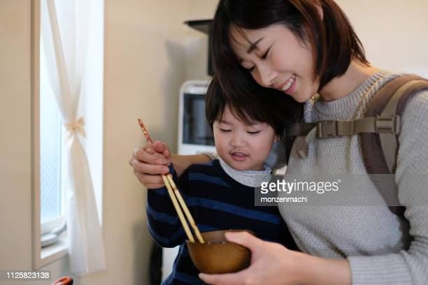 child cooking with mother in kitchen - homemaker stock pictures, royalty-free photos & images