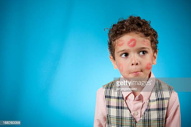 child covered with lipstick kisses - funny cupid stock pictures, royalty-free photos & images