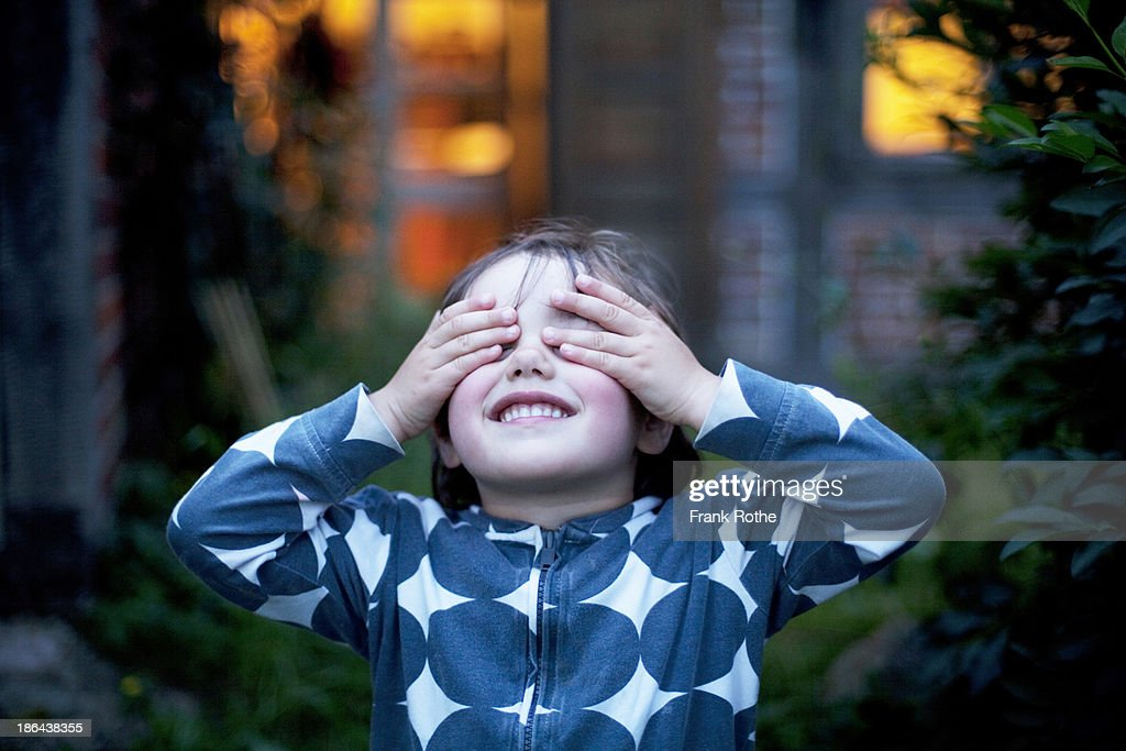 child covers the eyes with both hands : Stock Photo
