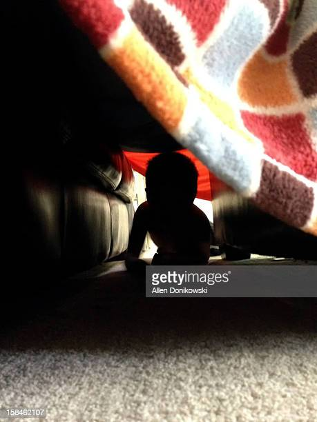 child crawling through tunnel