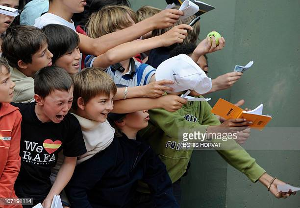 A child cries as he couldn't get an autograph at the end of the match between Argentina's Leonardo Mayer and France's Julien Benneteau in the French...