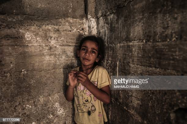 TOPSHOT A child cries during the funeral of a 24 yearold Sabri Ahmed Abu Khader in Gaza City on June 18 2018 Sabri was killed by Israeli fire near...