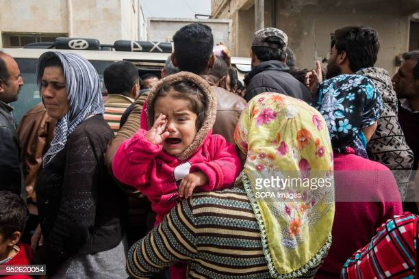 A child cries out as her mother waits to receive aid from the Kurdish Red Crescent in Tall Rifat An estimated 400000 refugees fleeing the twomonthold...