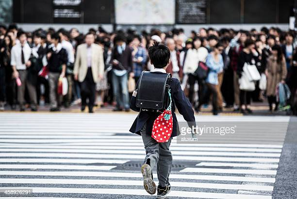 Child crossing busy street in Tokyo Japan