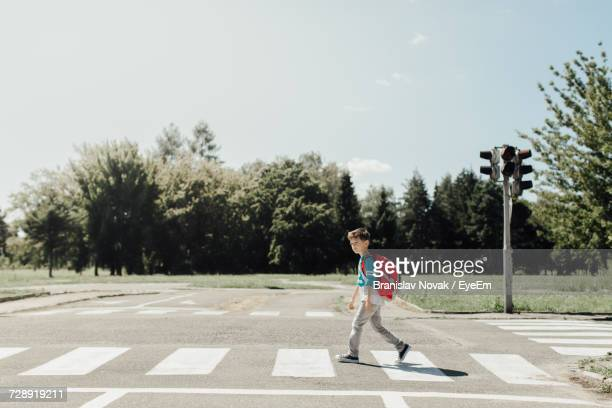 child crossing street - pedestrian crossing stock photos and pictures