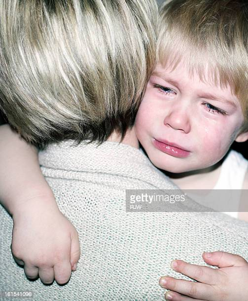 Child Crying in Mothers Arms