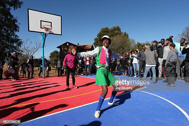 A child dances during the NBA Cares Court Dedication as part of the Basketball Without Boarders program on July 31 2015 at the SOS Children's Village...