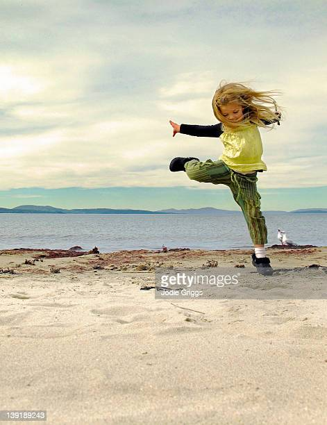 Child dancing on beach
