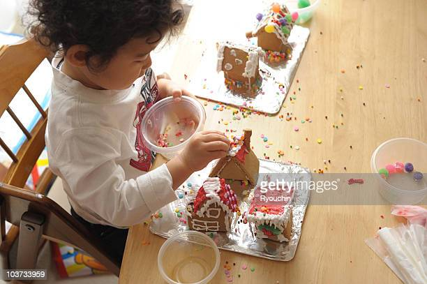 Child decorating sweets