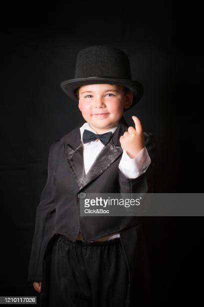 child disguised as gentleman with smoking - click&boo fotografías e imágenes de stock