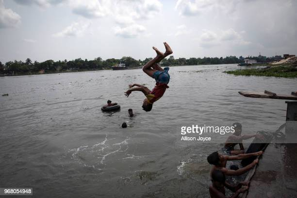 A child dives into the Buriganga river on June 3 2018 in Dhaka Bangladesh Bangladesh has been reportedly ranked 10th out of the top 20 plastic...