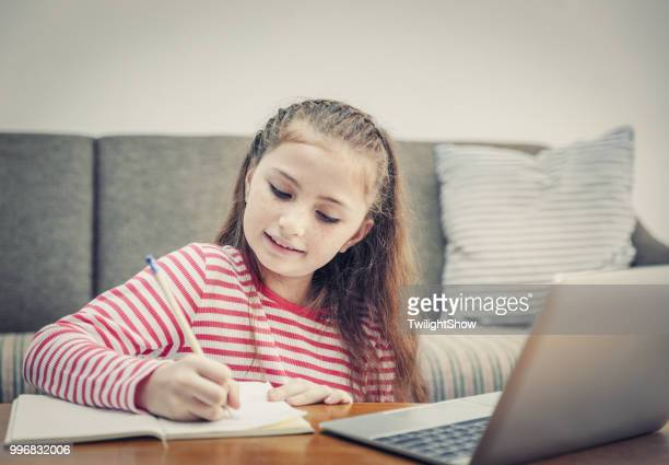 child doing homework at home - little girls webcam stock photos and pictures