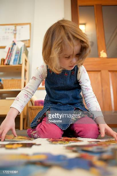 child doing puzzle in school - montessori education stock pictures, royalty-free photos & images