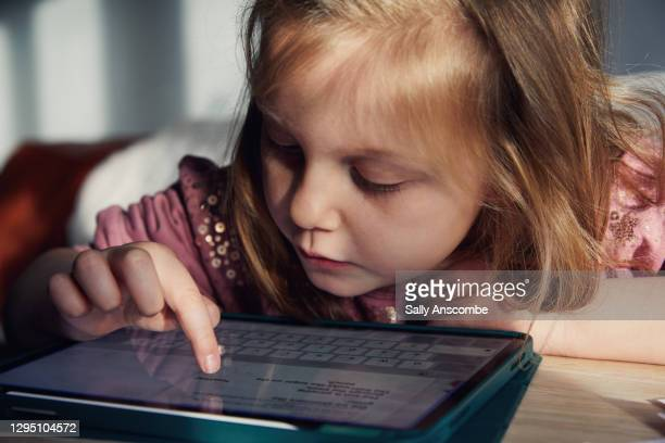 child doing school work at home - gender identity stock pictures, royalty-free photos & images
