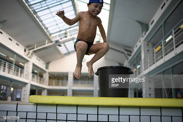 Child down's syndrome Jordan Joumana 4 years old and his father at a meeting of baby swimming pool Hebert Photo by BSIP / UIG via Getty Images