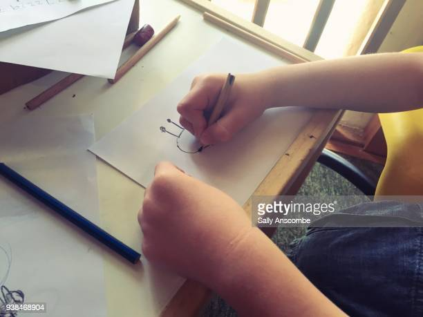 child drawing a picture of a bee - butterfly pencil drawings stock pictures, royalty-free photos & images