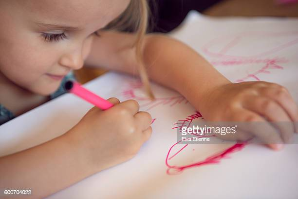 Child (3-4) drawing a picture