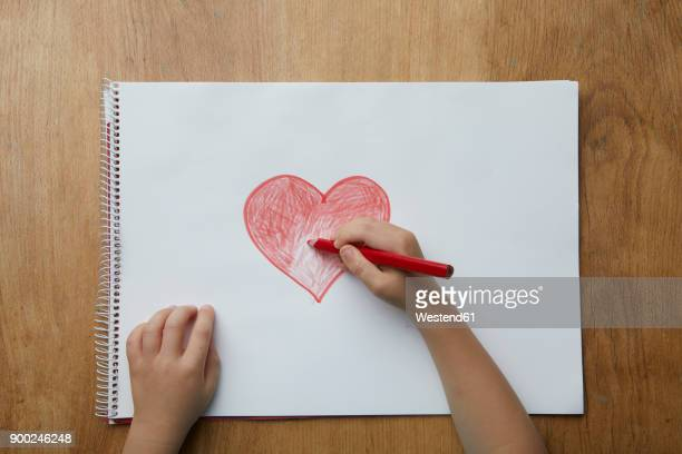 Child drawing heart