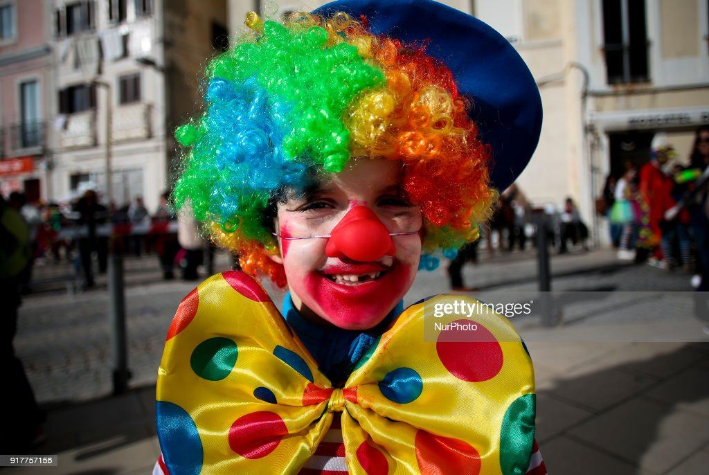 A child dressed as a clown takes part on the Carnival Clown's Parade at Sesimbra village on February 12, 2018.