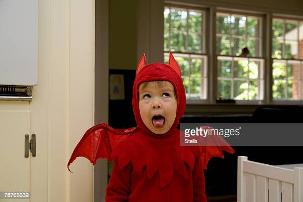 a child dressed as a devil - devil costume stock photos and pictures