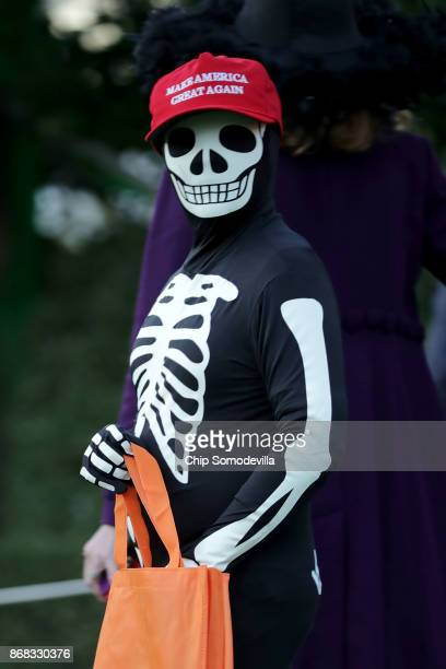 A child dressed as a skeleton with a Make America Great Again hat attends Halloween at the White House on the South Lawn October 30 2017 in...