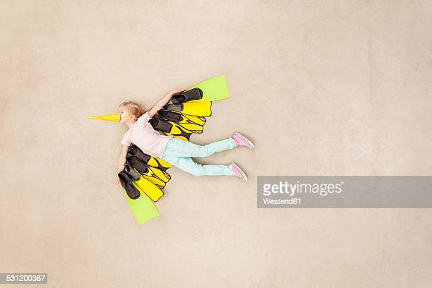 Child dressed as coloful bird