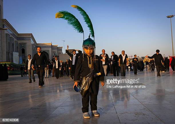 Child dressed as iman Hussein in a procession during Muharram celebrations in Fatima al-Masumeh shrine, Central County, Qom, Iran on October 8, 2016...