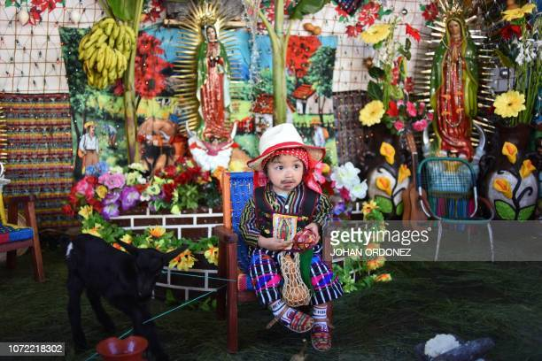 A child dressed as indigenous peasant Juan Diego is seen during the celebration of the anniversary of the apparition of the Virgin of Guadalupe to...