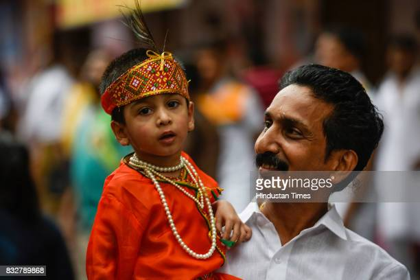 A child dressed as Krishna during Dahi Handi celebrations at Dadar on August 15 2017 in Mumbai India The childgod Krishna and his friends used to...