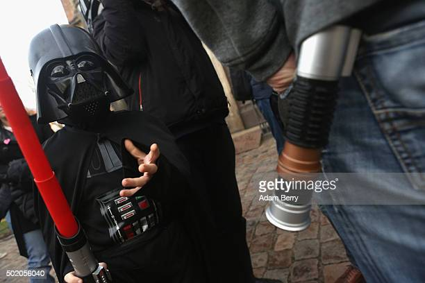 A child dressed as the Star Wars character Darth Vader arrives for a church service centered around the 1983 film 'Star Wars Episode VI Return of the...
