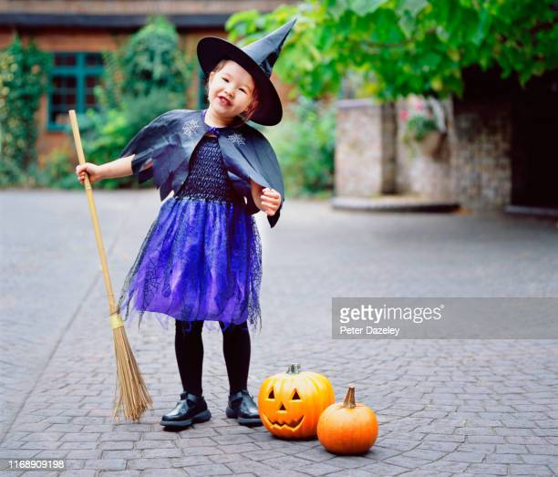 child dressed as witch for halloween - naughty halloween stock photos and pictures