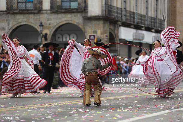 Child dressed in Charro performs with a rope while participating in a parade commemorating the 20th anniversary of the International Mariachi and...