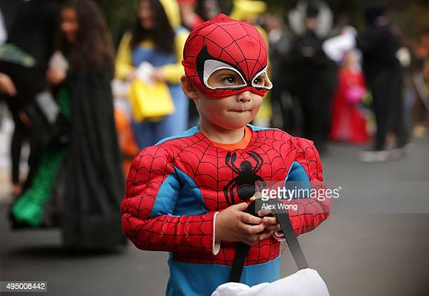 A child dresses as Spiderman as he participates in a Halloween event at the South Lawn of the White House October 30 2015 in Washington DC The first...