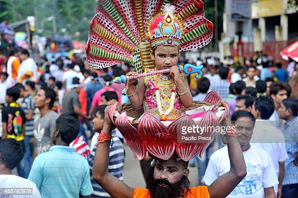 A child dresses like Lord Krishna during the colorful Janmashtami parade in Dhaka Janmashtami is the birth anniversary of Hindu God Sree Krishna...