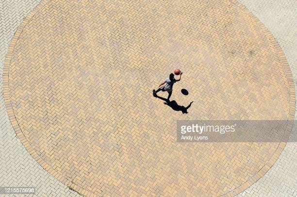 Child dribbles a basketball at Waterfront Park in downtown on March 29, 2020 in Louisville, Kentucky. Out of the concern of COVID-19 all of the...