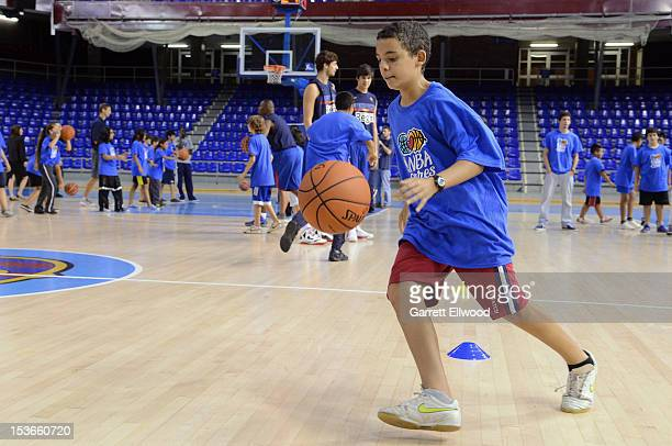 A child dribbles during a NBA Cares Clinic featuring the Dallas Mavericks during NBA Europe Live 2012 on October 8 2012 in Barcelona Spain NOTE TO...