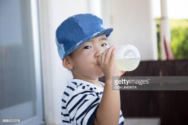 child drinking juice