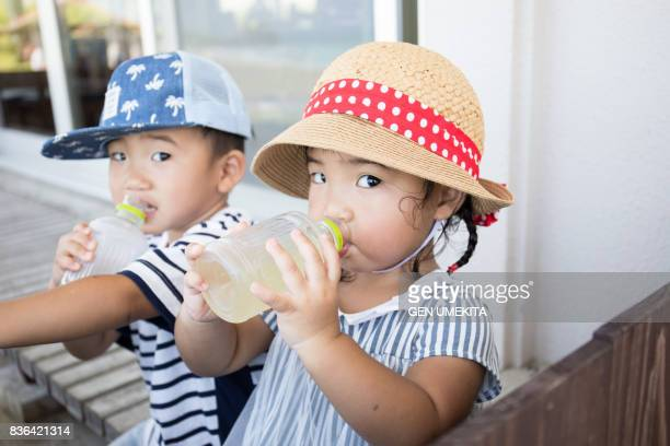 child drinking juice - thirsty stock pictures, royalty-free photos & images