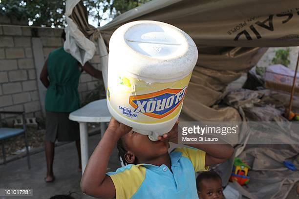 A child drinks from a bottle that was containing bleach or soap at the Faith Hope Love Infant Rescue Orphanage managed by a US citizen named Dorothy...