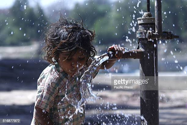 A child drinks water from a manual water pump Pakistanis take part in the eve of World Water Day World Water Day is celebrated every 22nd day of...